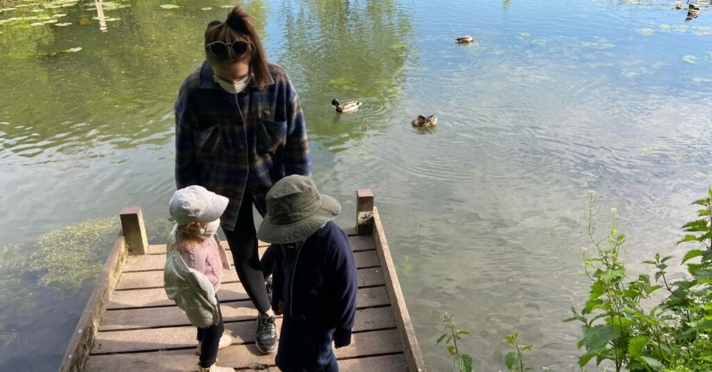 Annie Dressner with her children at a pond, behind the scenes for Mother Church Pew Blog
